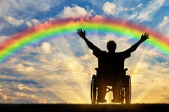 disabled-person-nurse-happy-rainbow-concept-sea-sunset-76733769